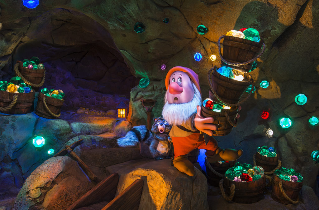 "A springtime opening is planned for the Seven Dwarfs Mine Train, a rollicking family-style coaster and the crown jewel of New Fantasyland at the Magic Kingdom Park. Walt Disney World Resort guests will be treated to an exciting, musical ride into the mine ""where a million diamonds shine"" as the lovable world of Sleepy, Doc, Grumpy, Bashful, Sneezy, Happy and Dopey comes to life. One feature will be first-of-its-kind ride vehicles mounted in cradle-like pivots that allow the vehicles to swing back and forth during the ride. Adding to the fun, the journey will be accompanied by beloved music from the Disney film classic. On their adventure, riders pass by animated figures of Snow White, the Seven Dwarfs and playful forest critters. The attraction will complete New Fantasyland, the largest expansion in Magic Kingdom history. Walt Disney World Resort is in Lake Buena Vista, Fla. (Matt Stroshane, photographer)"